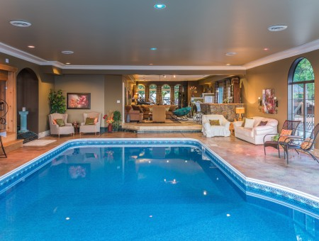 Home indoor pool with bar  Indoor Pool - One Of A Kind EstatesOne Of A Kind Estates